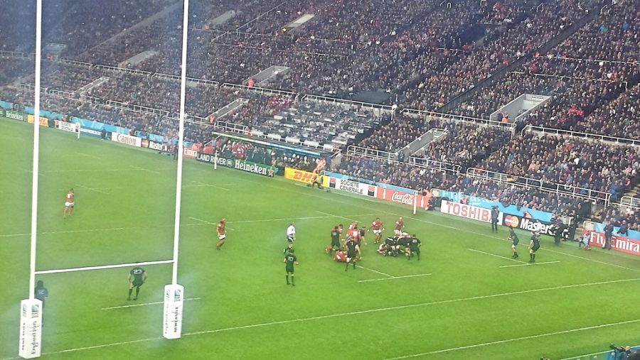 Rugby players tackling within the match during the RUGBY WORLD CUP NEWCASTLE 2015