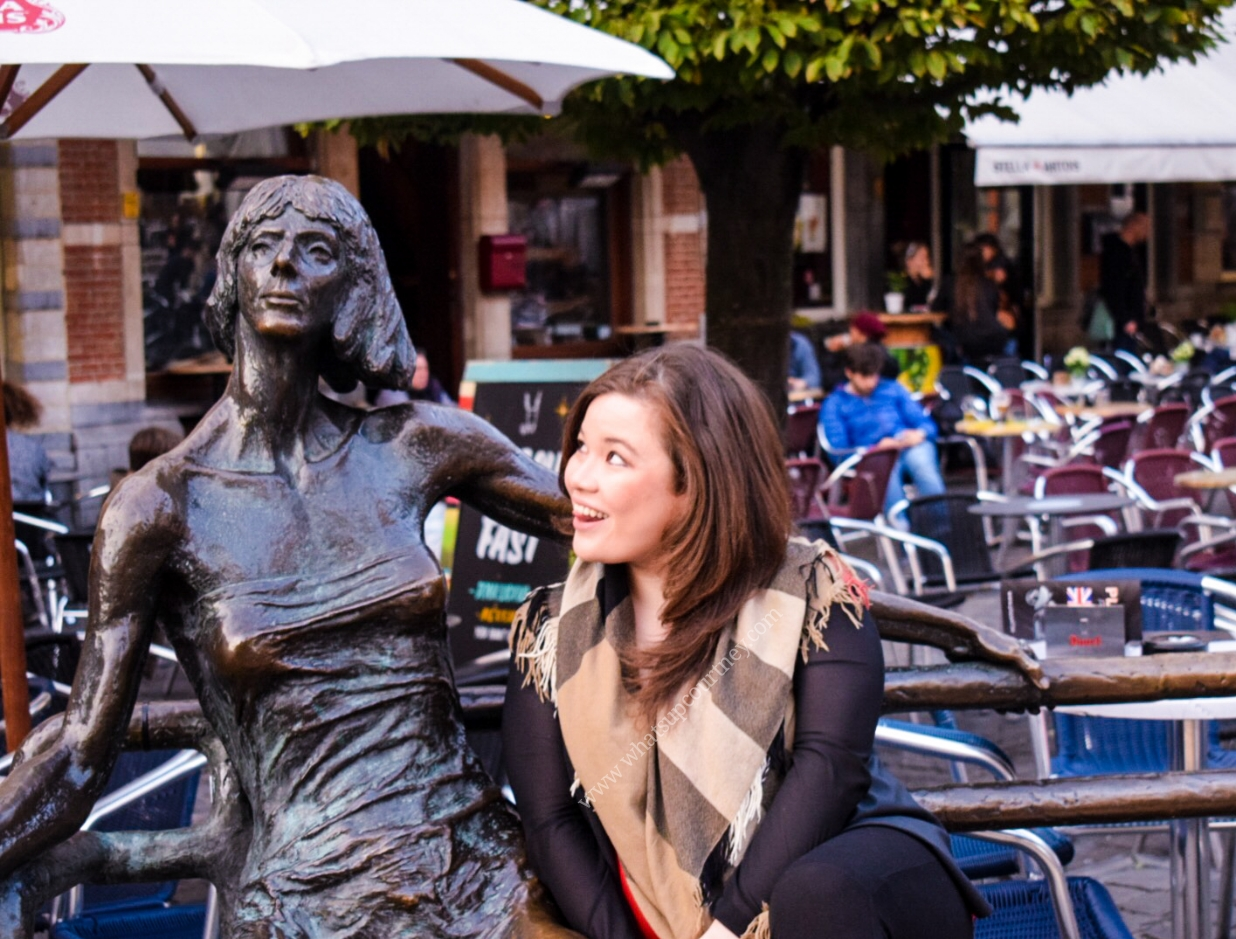 De Kotmadam statue in Leuven's Oude Markt (the longest bar in Europe), read more about what you can do in Leuven in 48 hours at www.whatsupcourtney.com #Leuven #travel #travelguide