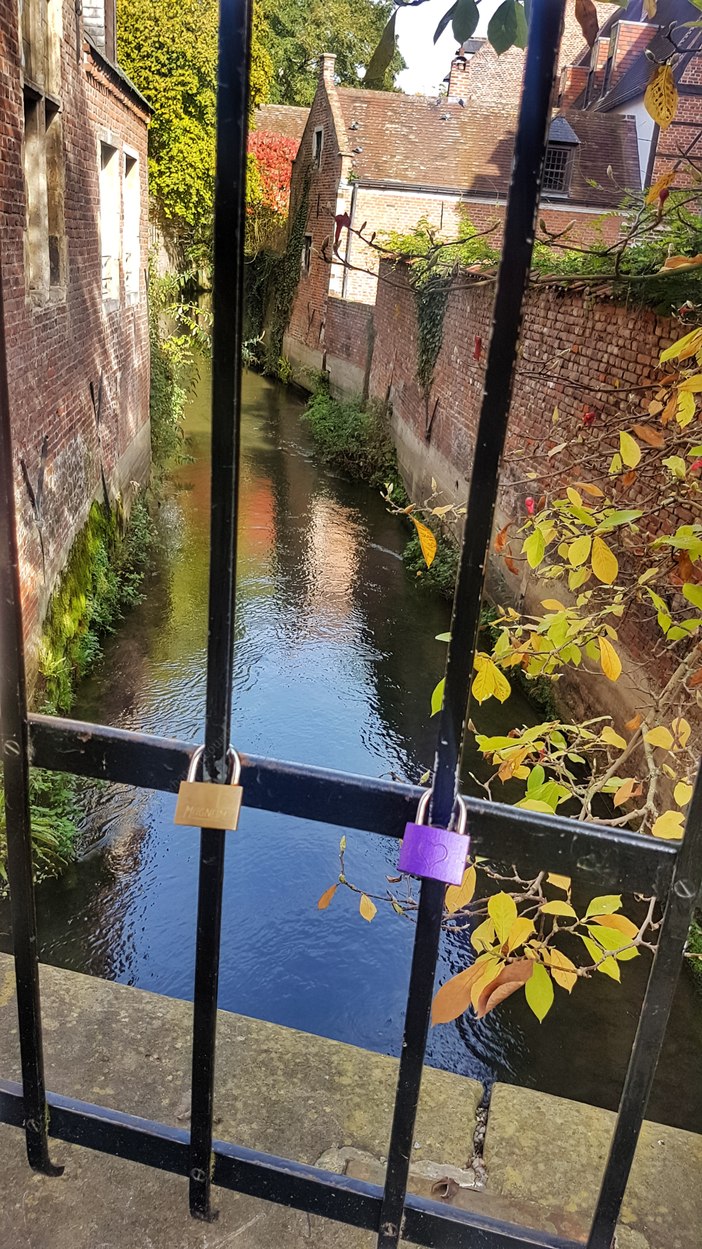 Love lock on a bridge of a small river at the Unesco heritage site, Groot Begijnhof - read more about what you can do in Leuven in 48 hours at www.whatsupcourtney.com #Leuven #travel #travelguide