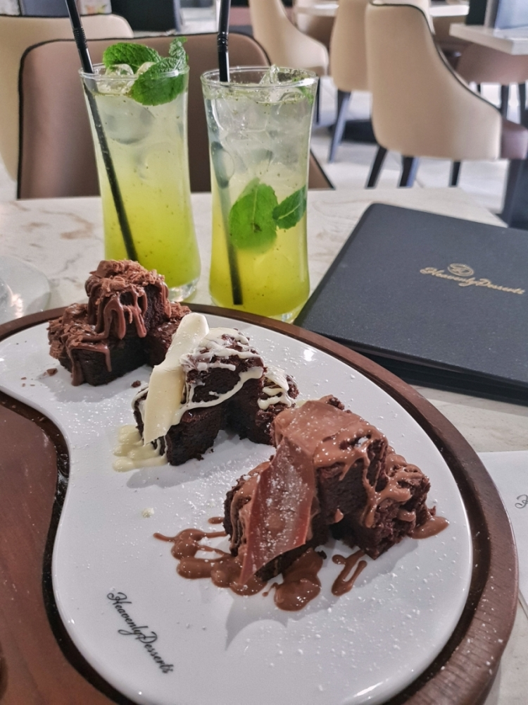 "A plate of mini brownies and 2 cocktails from Heavenly Desserts in Bradford -></noscript></noscript> www.whatsupcourtney.com #dessert #brownies #bradford #england"" width=""750″ height=""1000″></a></p> <p><em>*Disclaimer: I was invited to Heavenly Desserts Bradford for their opening event. As always, the review and opinions are of my own*</em></p> <p>Should you find yourself in Bradford anytime soon, I have a place for you to check out.</p> <p>Dessert lovers, this is all for you!</p> <p>Up a hilly road near the University along Great Horton Road is a newly opened Heavenly Desserts Bradford, filled with desserts to your heart's desire.</p> <p><img width="