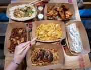 An array of dishes including a chargrilled wrap, Nasi Goreng, Chicken Teriyaki Noodles, Chicken wings and Thai Green Curry from Canaca World Street food restaurant in Newcastle Upon Tyne