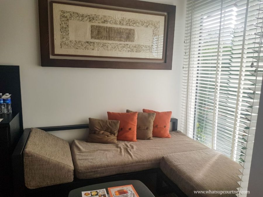 The sofa lounge area in the room at The Andaman resort in Langkawi | heywhatsupcourtney