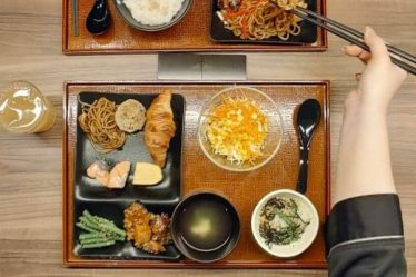Breakfast for two at Candeo Hotels- Japanese hamburger which is a must try fried soba, sweet omelette, yoghurt, stew and rice plus ginger soup and miso at Candeo Hotels Osaka Namba in Japan - read more at www.whatsupcourtney.com