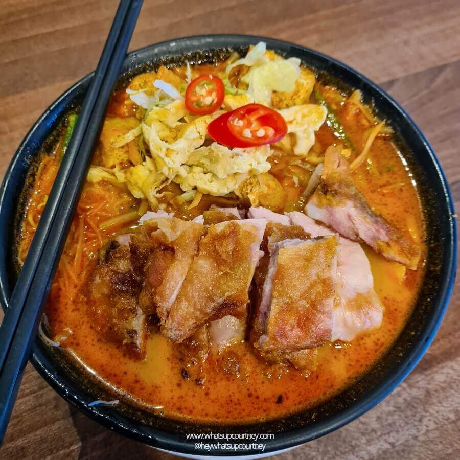 A bowl of Chicken Laksa with fried chicken, veg and vermicelli