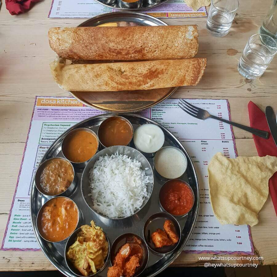 Masala dosa, a chickpea flour based Indian crepe with masala potato filling with a thali tray