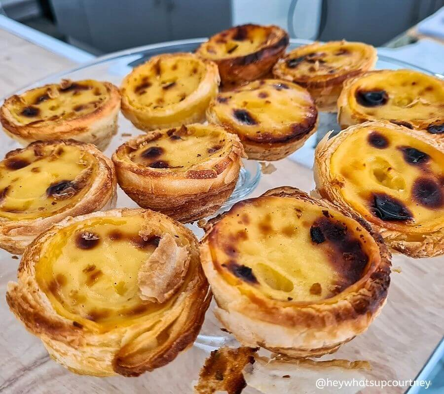 Flaky, thick sweet custard and delicious pasteis de nata or known as Portuguese custard tarts - this was at the Portuguese Cafe in Newcastle UK - www.whatsupcourtney.com